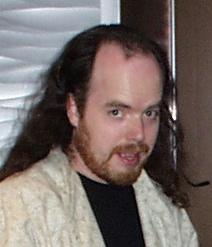 Tom Hall en la época. Como se puede sospechar ahora tiene aún menos pelo